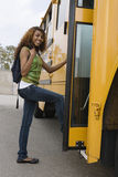 Teenage Girl Boarding School Bus Stock Images