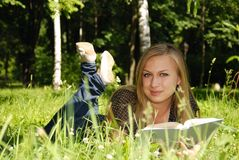 Teenage girl with book. Teenage blond girl with book Stock Photography