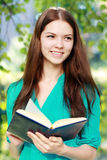 Teenage girl with book Royalty Free Stock Photo
