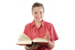 Teenage girl with book and pencil in here hands, smiling into ca Stock Photos