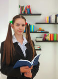 Teenage girl with a book stock images