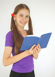 Teenage girl with a book royalty free stock image
