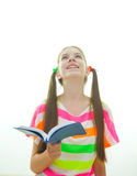Teenage girl with a book stock photo