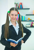Teenage girl with a book Stock Photography