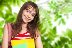 Teenage girl with books outside Stock Photo