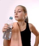 Teenage girl with bottle of water after exercising Royalty Free Stock Photography