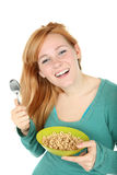 Teenage girl with a bowl of cereal Royalty Free Stock Photography