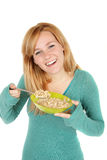 Teenage girl with a bowl of cereal Stock Image