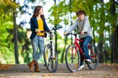 Teenage girl and boy biking Stock Photos
