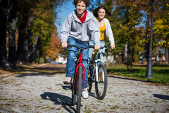 Teenage girl and boy biking Royalty Free Stock Image