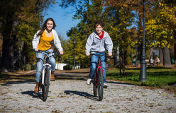 Teenage girl and boy biking Royalty Free Stock Images