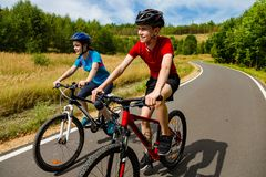 Teenage girl and boy cycling stock photo