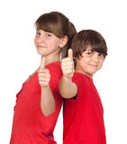 Teenage girl and boy dressed in red saying OK Royalty Free Stock Photos