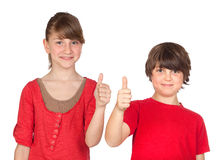 Teenage girl and boy dressed in red saying OK Royalty Free Stock Image