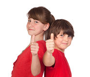 Teenage girl and boy dressed in red saying OK Stock Image