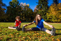 Teenage girl and boy exercising outdoor Stock Image