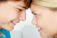 Teenage girl and boy with the heads touching Royalty Free Stock Photo