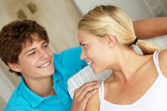 Teenage girl and boy looking at one another Royalty Free Stock Photos