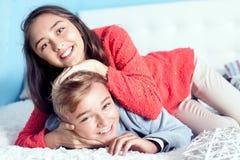 Teenage girl and boy playing Stock Images