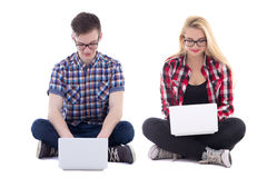 Teenage girl and boy sitting with laptops isolated on white Stock Photo