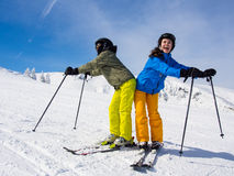 Teenage girl and boy skiing Royalty Free Stock Photo
