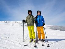 Teenage girl and boy skiing Royalty Free Stock Images