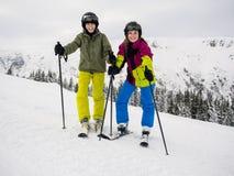 Teenage girl and boy skiing Stock Images