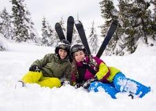 Teenage girl and boy skiing. Winter sports - teenage girl and boy skiing stock photography