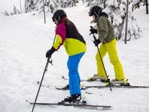 Teenage girl and boy skiing Stock Photos