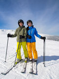 Teenage girl and boy skiing Stock Photography