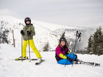 Teenage girl and boy skiing Stock Image