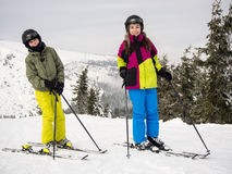 Teenage girl and boy skiing Stock Images