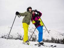 Teenage girl and boy skiing Royalty Free Stock Image