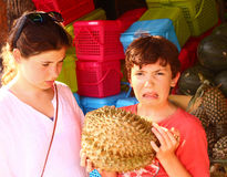 Teenage girl and  boy smell durian Stock Photo