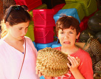 Teenage girl and  boy smell durian Stock Photography