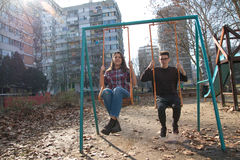 Teenage girl and boy on the swing Stock Photos