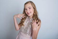 Teenage girl with braces. Pretty teenage girl with braces and a formal dance dress stock photo