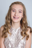 Teenage girl with braces. Pretty teenage girl with braces and a formal dance dress Stock Photos