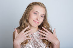 Teenage girl with braces. Pretty teenage girl with braces and a formal dance dress Stock Images