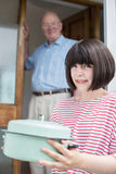 Teenage Girl Bringing Meal For Elderly Male Neighbour Royalty Free Stock Photography