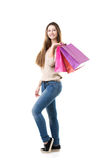 Teenage girl with broad smile holding pink shopping bags Stock Images