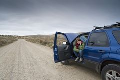 Teenage girl with a broken car Royalty Free Stock Photography