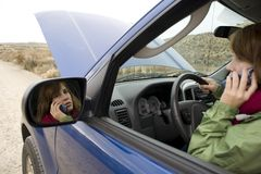 Teenage girl with a broken car Royalty Free Stock Images