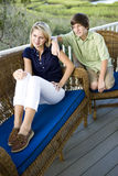 Teenage girl and brother sitting on terrace Royalty Free Stock Image