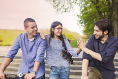 Teenage girl with brothers Stock Photo