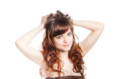 Teenage girl in brown dress. Isolated over white background. Stock Images