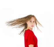 Teenage girl with brown hair in motion Stock Photography