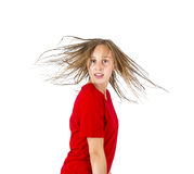Teenage girl with brown hair in motion Stock Images
