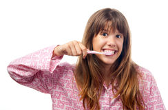 Teenage girl brushing her teeth Stock Images