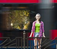 Teenage girl on a bus stop royalty free stock photography